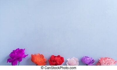 Paper flowers growing - Colorful paper flowers growing on...