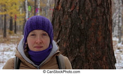Portrait of a girl near a big old tree, larch. Close-up