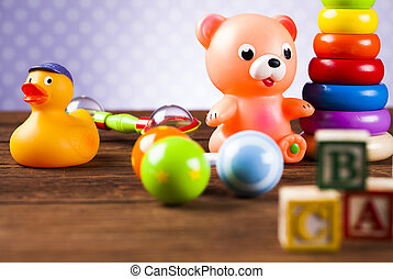 Children's of toy accessories on wooden background - Set of...