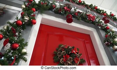 Broaching view of the door decorated for Christmas -...