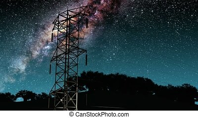 Electricity pylons and lines. Milky Way stars at night....
