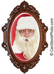 Santa Claus reflected in old mirror with wooden frame