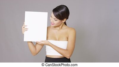 Lady holding a large blank card in her hands - Beautiful...