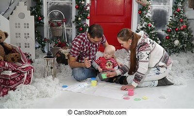 Dad paint spoil the child sitting in the snow