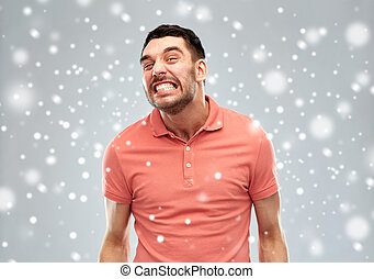 angry man over snow - emotion, anger, winter, christmas and...