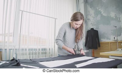 Creative profession. Woman creates designer clothes. Seamstress