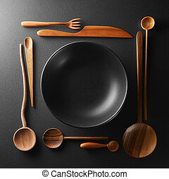 frame of setting empty plate and wooden cutlery - frame of...