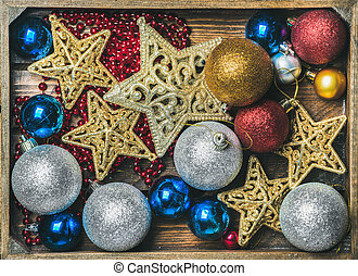 Christmas tree glittering toy stars, colorful balls and...