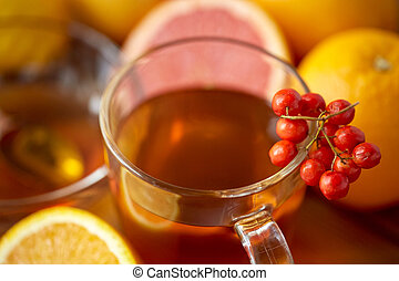 close up of tea cup with rowanberry - health, traditional...