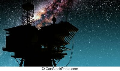 Silhouette of oil rig and Milky Way stars at night. Elements...