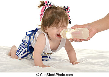 Girl crying while drinking milk