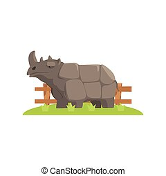 Grey Rhinoceros Standing On Green Grass Patch In Open Air...