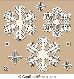 Paper cut snowflakes with dropped shadow over brown...
