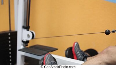 The Guy Does Exercises On The Exercise Machine