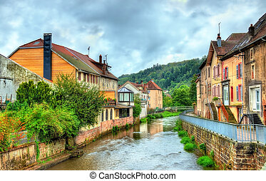 View of Moyenmoutier, a town in the Vosges Mountains -...