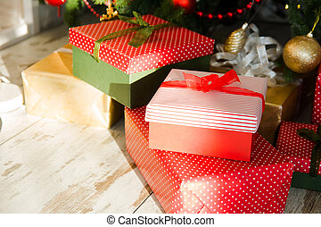 Red boxes packed with Christmas gifts