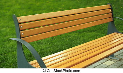 Young lady sitting on a bench after long running distance...