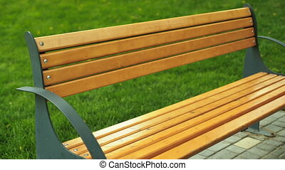 Young funny woman sitting on a bench and relaxing after long...