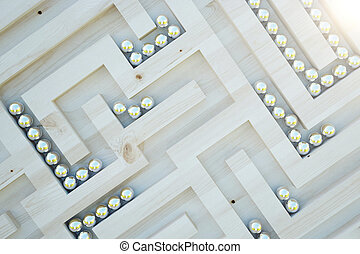Challenge concept - Closeup of wooden maze with abstract...