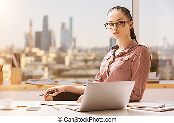 Portrait of woman at workplace - Portrait of thoughtful...