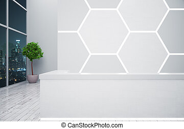 White reception desk with honeycomb pattern on wall,...