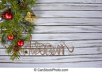 Christmas pine bough on wood - word dream in copper wire...