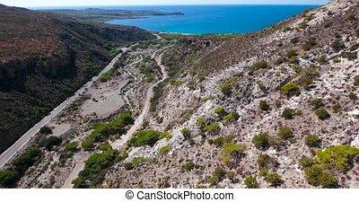 road through mountains to sea at crete Greece