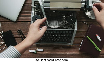 Man typing on typewriter - Cropped shot of typist working on...