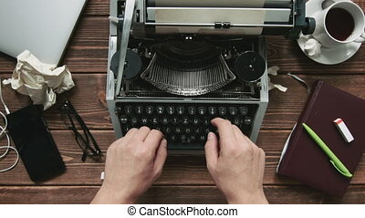 Man working on typewriter - Cropped shot of man typing on...