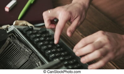 Person working on typewriter - Cropped shot of person's...