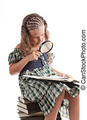Cute girl holding magnifying glass