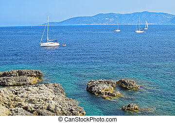 Adriatic coast with sailing boat in autumn