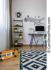 Room with stave on the wall - Shot of a modern teenager's...