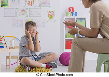 Misbehaving boy during session with a psychotherapist -...