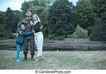 Soldier spending time with his wife and son - Image of a...