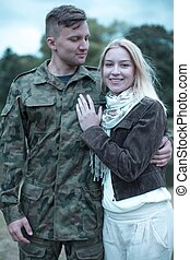 Soldier embracing his smiling wife - Happy young soldier...