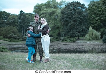 Soldier and his beloved family - Soldier spending time with...