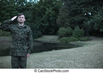 Soldier wearing military uniform - Image of a young soldier...