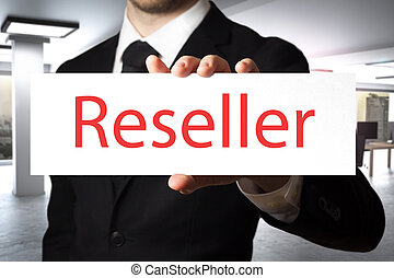 businessman holding sign reseller - businessman in office...