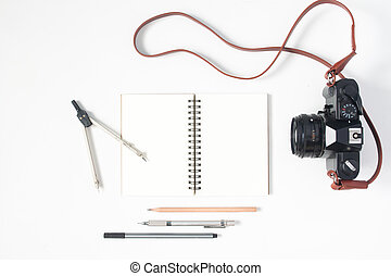 Flat lay of stationery notebook with copyspace and camera...