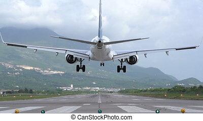 landing plane rear view slow motion