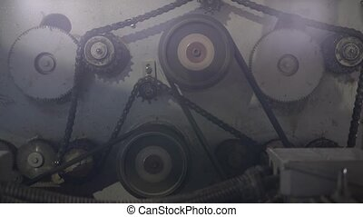Timber mill. View of gears and chain rotate on machine