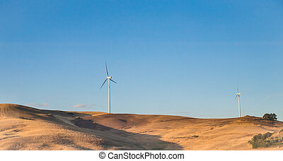 Eolic energy turbines in countryside. Sicily