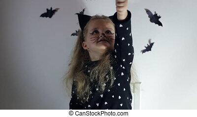 Girl in cat Halloween costume