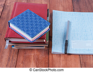 Lying on a white background with school supplies. - School...