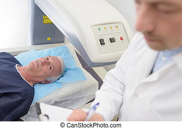 senior patient undergoing mri scan at hospital