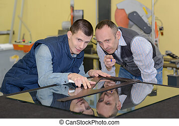 apprentice and teacher glazier in the workshop