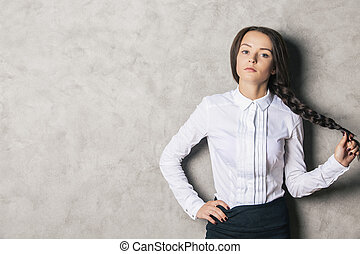 Attractive girl on concrete background - Portrait of...
