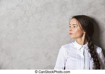 Pretty female on concrete background - Portrait of pretty...