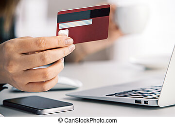 Online payment concept - Girl holding credit card while...